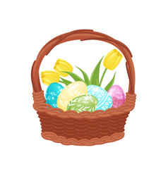 brown wicker basket full of painted eggs and tulip vector image
