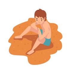 Boy sitting and sunbathing on sandy beach vector