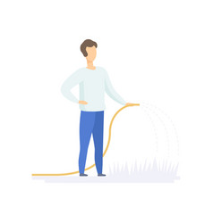 Young man watering plants in the garden with hose vector