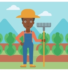Farmer with rake vector