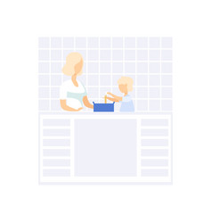 young mom cooking in the kitchen her little son vector image