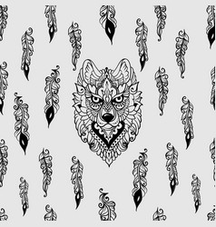 Seamless pattern with wolf and feathers vector