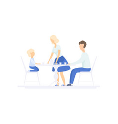 Family eating dinner together at kitchen table vector