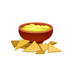 Nnachos and cheese sauce in brown ceramic bowl vector