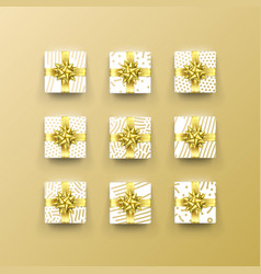 christmas gift box present in golden ribbon bow vector image