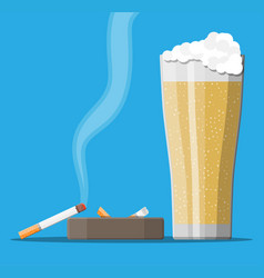 Glass of beer with cigarette and ashtray vector