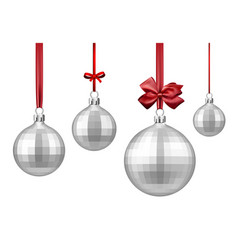 Silver christmas balls with red bow vector