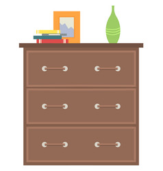 Wooden drawer furniture with home decor vase book vector