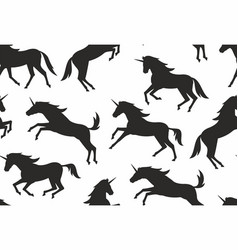 Seamless pattern with unicorns silhouettes vector