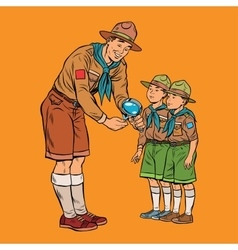 Scoutmaster shows little insect to young scouts vector