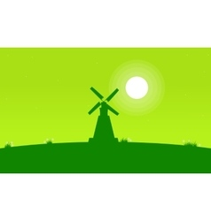 Silhouette of windmill with green background vector image