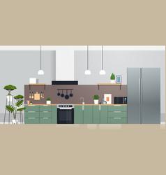 Modern kitchen interior with new refrigerator oven vector