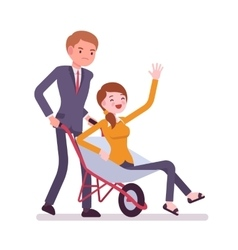 Man pushing a lady in the wheelbarrow vector image vector image