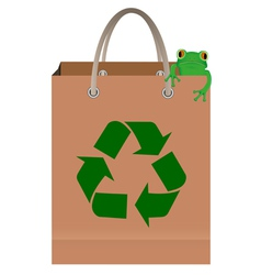 frog sitting on paper bag with recycle symbol vector image