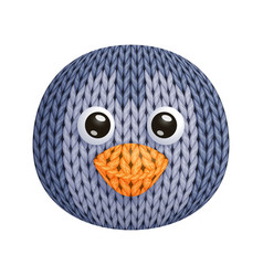 A funny knitted penguin toy head on white vector