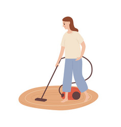 smiling housewife cleaning carpet with vacuum vector image