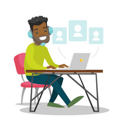 A black man in headset working at the office desk vector