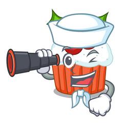 Sailor with binocular decorated christmas cupcakes vector