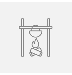 Cooking in cauldron on campfire line icon vector image