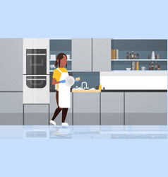Young woman washing dishes african american girl vector