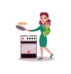 Mother baking pancakes with baby in her arms vector