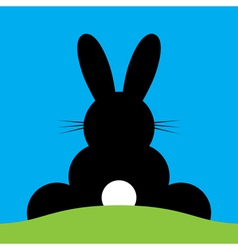 Sitting back Easter bunny vector