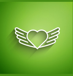 White line heart with wings icon isolated on green vector