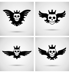 Skull with crown and wings vector