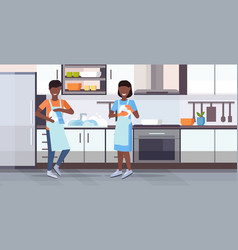 Man woman washing dishes wiping plates with towel vector