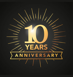 10 anniversary gold numbers with golden banner vector image