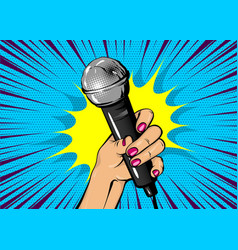 Woman pop art hand hold microphone vector