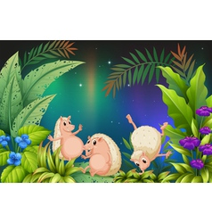 Three wild animals playing in the garden vector