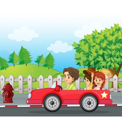 A young gentlemen driving a car with two ladies at vector image vector image