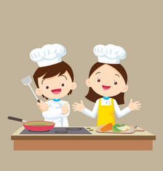 Cute little chef boy and girl vector