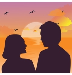 Silhouette of a couple kissing against a sunset vector image vector image