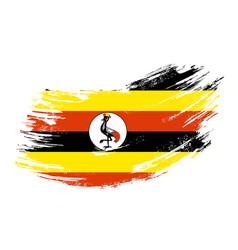 Ugandan flag grunge brush background vector