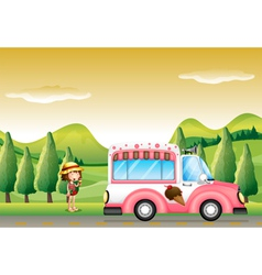 A pink ice cream bus and the little girl vector image