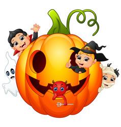 Happy halloween character in the big pumpkin vector