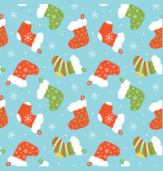 seamless pattern with christmas stocking vector image