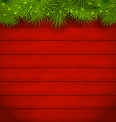 Christmas wooden background with fir twigs vector image