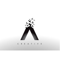 A logo letter with flock of birds flying and vector