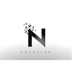 N logo letter with flock of birds flying and vector