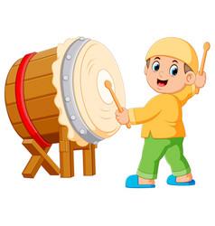 A boy playing bedug cartoon vector