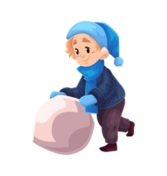 Little boy in winter clothes making a snowman vector image