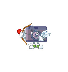 A lovely retro camera cupid with arrow and wings vector