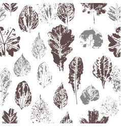 Seamless pattern with stamp leaves vector