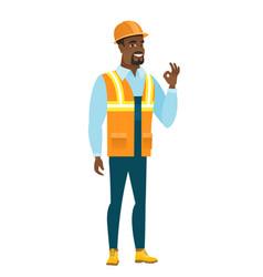 smiling builder showing ok sign vector image