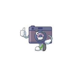 A mascot icon retro camera making thumbs up vector