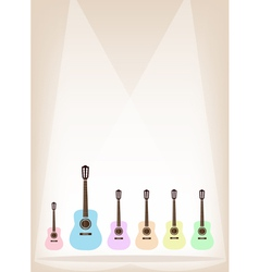 Six Colorful Guitar on Brown Stage Background vector image