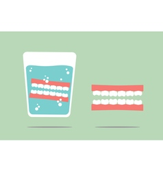 Denture in water glass vector